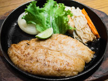 Fried sole fish. On hot plate Stock Photo