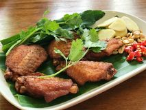 Fried sour chicken wings, Thai food. Fried sour chicken wings served with ginger, chili and peanut, Thai food Stock Image