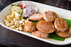 Fried Sour pork. With peanut Shallots Pepper Ginger in dish Stock Image