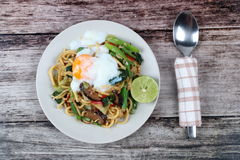 Fried sour sweet Chinese noodle with soft-boiled egg. Royalty Free Stock Photo