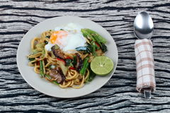 Fried sour sweet Chinese noodle with soft-boiled egg. Royalty Free Stock Images