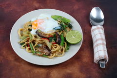 Fried sour sweet Chinese noodle with soft-boiled egg. Stock Image