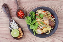 Fried sour sweet  Chinese noodle with tofu with side dish are Thai organic food. Fried sour sweet  Chinese noodle with tofu,mushroom,red chili,bean sprouts Royalty Free Stock Photography