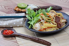 Fried sour sweet  Chinese noodle with tofu with side dish are Thai organic food. Selective focus. Stock Photos