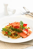 Fried Spaghetti with ham and sausage, Spicy fusion Thai food. Spaghetti with mussel, white Fried Spaghetti with ham and sausage, Spicy fusion Thai food royalty free stock image