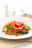 Fried Spaghetti with ham and sausage, Spicy fusion Thai food. White background stock photo