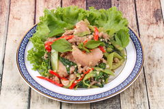 Fried spicy basil with minced pork topped lettuce. Royalty Free Stock Photography
