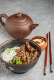 Fried spicy beef with sesame seeds, green beans and rice noodles Stock Photos