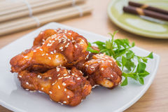 Fried spicy chicken with sesame seeds on plate Royalty Free Stock Photography
