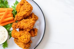 Fried spicy chicken wings. With vegetable stock photo