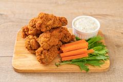 Fried spicy chicken wings. With vegetable royalty free stock photo