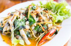 Fried Spicy Herbal Vegetables With Razor Clams. Thai Food Local in SamutSongKhram Province Thailand stock photography