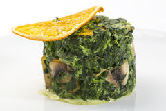 Fried spinach Stock Photos