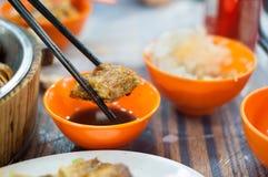 Fried spring roll held by chopsticks at a Hong Kong dai pai dong Royalty Free Stock Photo