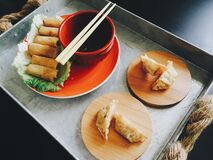 Fried Spring Rolls and Dumplings on Top of Tray Royalty Free Stock Photos