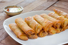 Fried Spring rolls food on wood background.  Stock Photo