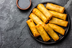 Fried spring rolls on iron plate. Top view Royalty Free Stock Photos
