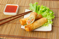 Fried spring rolls, one cut, on a plate Royalty Free Stock Photo