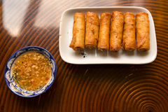 Fried spring rolls with peanut sauce Stock Images