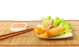 Fried spring rolls on a plate against white background Royalty Free Stock Photo
