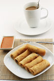 Fried spring rolls or popiah with coffee Stock Photo