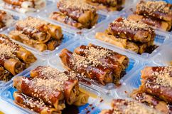 Fried spring rolls or Popiah is a famous Malaysian traditional street food with selective focus. Close-up view of fried spring rolls or Popiah is a famous royalty free stock images
