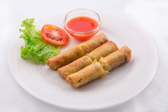 Fried spring rolls with red chilli sauce, tomato and lettuce isolated Royalty Free Stock Image