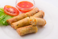 Fried spring rolls with red chilli sauce, tomato and lettuce  Stock Photography