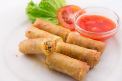 Fried spring rolls with red chilli sauce, tomato and lettuce  Royalty Free Stock Photography