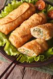 Fried spring rolls sliced on a plate closeup. top view vertical Stock Photography