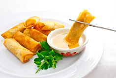 Fried springroll dip into sweet plum sauce Royalty Free Stock Image