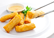 Fried springrolls with chopsticks Royalty Free Stock Photos