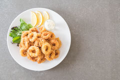 Fried squid calamari rings. On the table royalty free stock photography