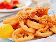 Fried squid. In a greek restaurant stock photos