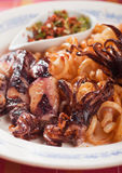 Fried squid with italian pasta Stock Image
