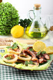 Fried squid with lettuce and lemon Royalty Free Stock Image