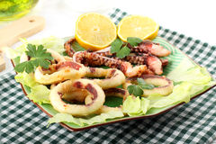 Fried squid with lettuce and lemon Royalty Free Stock Images