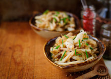 Fried Squid with Onions and Chives, vintage effect, copy space for your text Stock Images