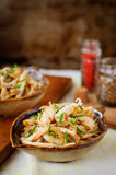 Fried Squid with Onions and Chives, vintage effect, copy space for your text Royalty Free Stock Image