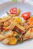 Fried squid with peppers, basil. Royalty Free Stock Image