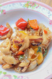 Fried squid with peppers, basil. Royalty Free Stock Photography
