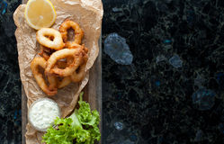 Fried squid rings in breading. Hot delicious squid rings fried in breadcrumbs Royalty Free Stock Photo