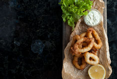 Fried squid rings in breading. Hot delicious squid rings fried in breadcrumbs Royalty Free Stock Photos