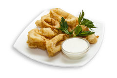 Fried squid rings. Food, dish, fish, seafood, parsley, sauce, beer snacks Stock Images