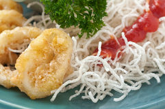 Fried squid rings witn noodles Stock Photo