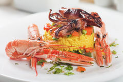 Fried squid with shrimps and risotto Royalty Free Stock Image