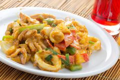 Fried squid in yellow curry powder, thai food. Royalty Free Stock Image