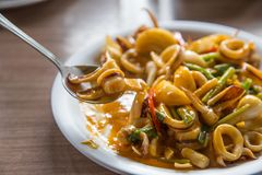 Fried squid with yolk egg soup serve with rice on dinner. Famous Thai seafood menu concept stock photography