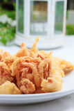 Fried squids at the restaurant. Table royalty free stock images