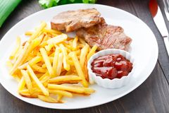 Fried steak with french fries Royalty Free Stock Image